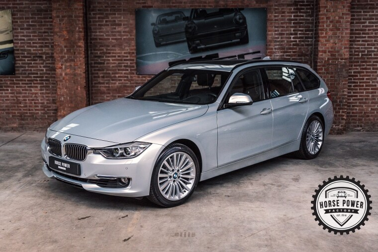 Foto van BMW 3 Serie Touring 328i High Executive
