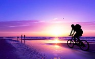 Cycling-at-sunset-on-the-beach-wallpaper