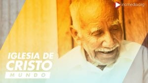 Medium candid shot of elderly latino man in white shirt