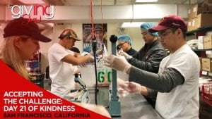Group of volunteers on assembly line for packing meals with overlay text Accepting The Challenge: Day 21 of Kindness. San Francisco, California