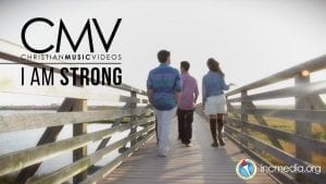 "People walking on wooden bridge with text overlay: ""I am strong"""
