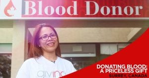 Volunteer stand in front of Blood Donor sign with overlay text Donating Blood: A Priceless Gift