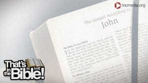 A Bible opened to the first page of the Book of John.