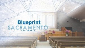 inside of worshio building with blueprint logo overlay