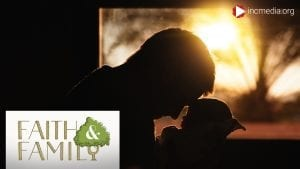 silhouette of man holding a baby