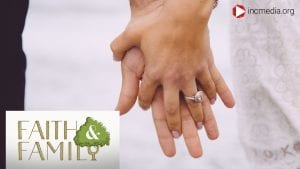 close up shot of married couple interlocking hands