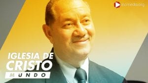 Puerto rican man dressed in a suit smiling and looking off to the side