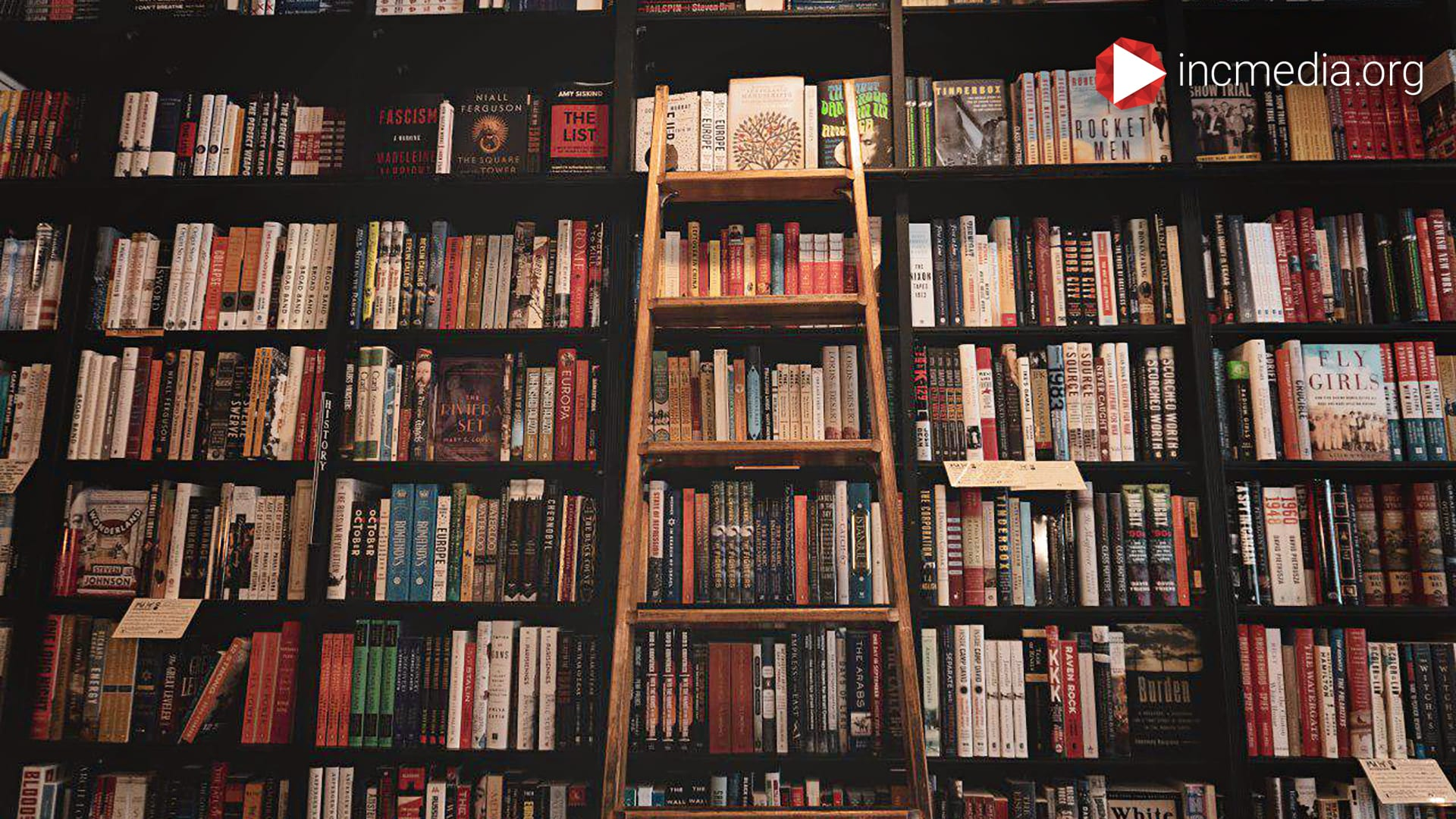 1. Bookshelf of books with ladder.