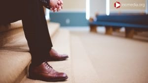 man-shoes-inside-church-building
