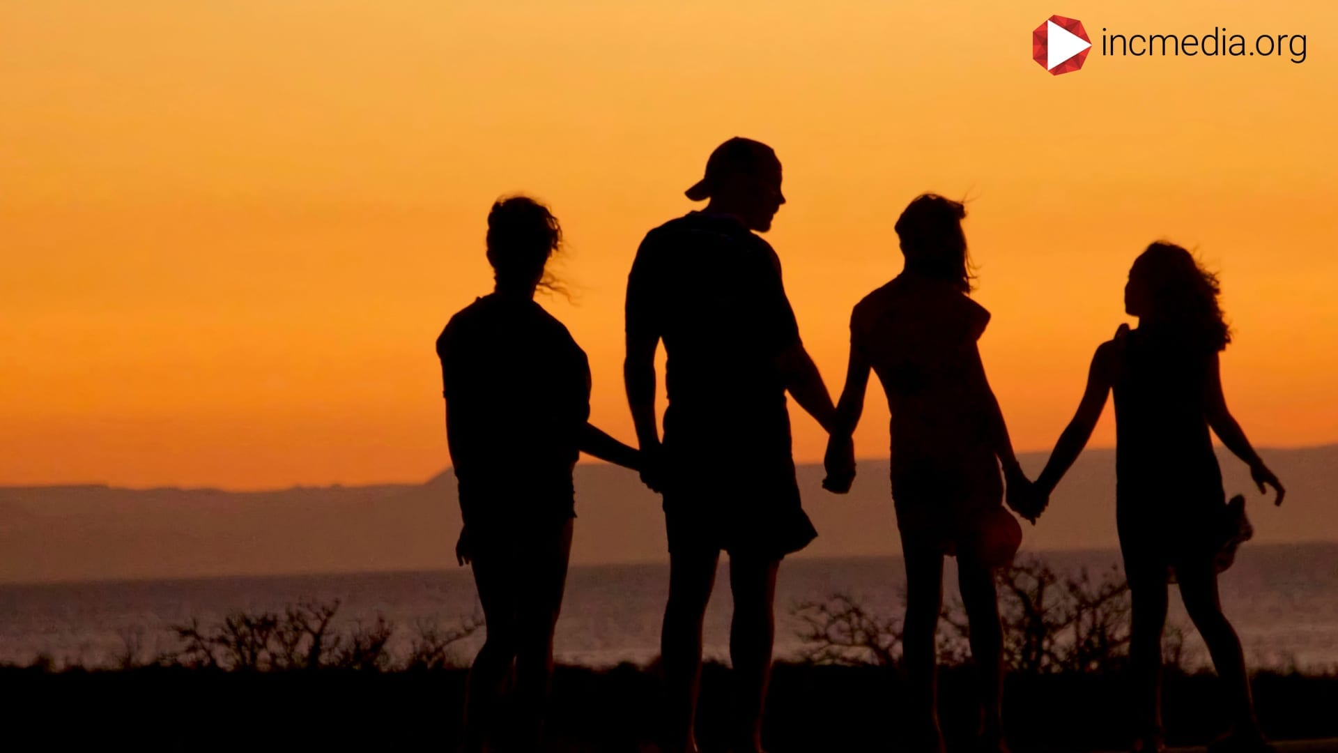 family of four silhouette together