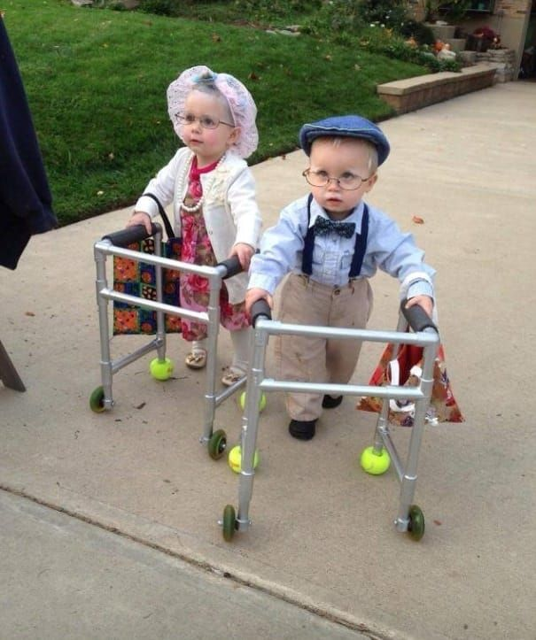Two kids dressed up as old people with a walker