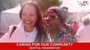 Two women standing next to each other smiling in a caring community in Seattle