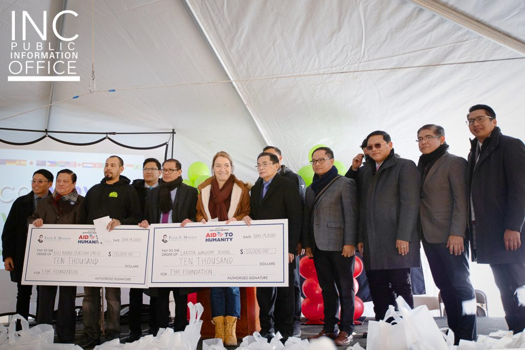 Tom Casey of KILI Radio and Isabel Stadnick of the Lakota Waldorf School both accepting their respective donations of $10,000 for their work in the Kyle, SD community. Donation from the Felix Y. Manalo Foundation presented by INC General Auditor Brother Glicerio Santos, Jr. and Ministers of the Gospel from the region.
