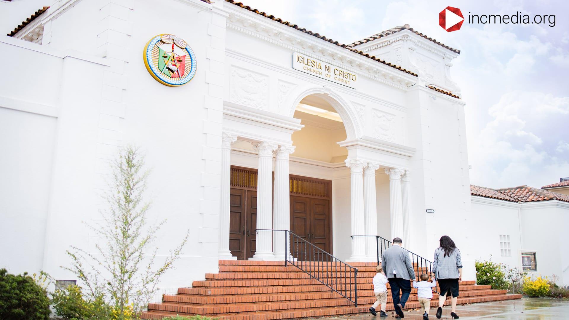 A family walking into a Iglesia Ni Cristo house of worship.
