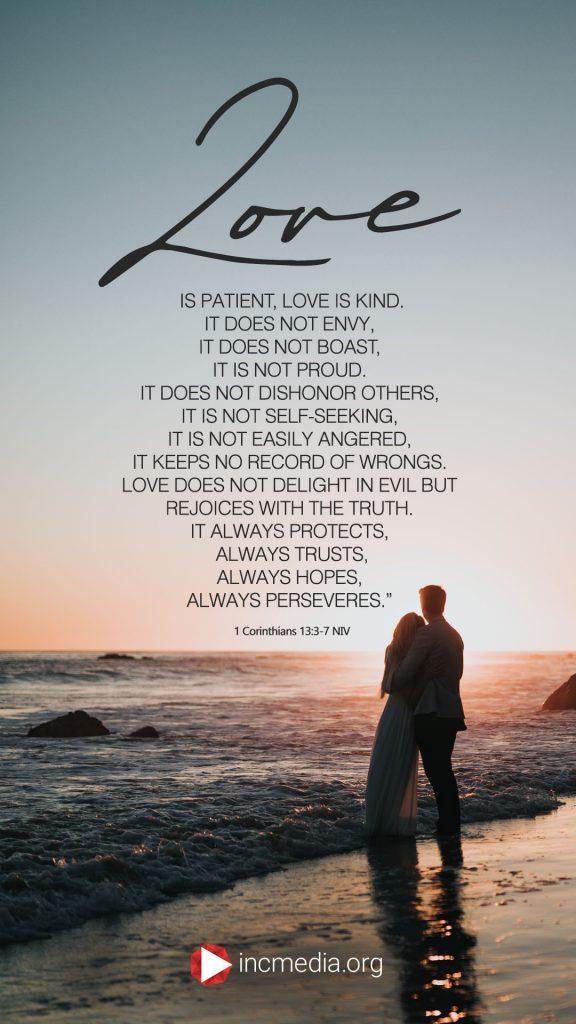 1 Corinthians 13:3-7 NIV couple standing at the beach.