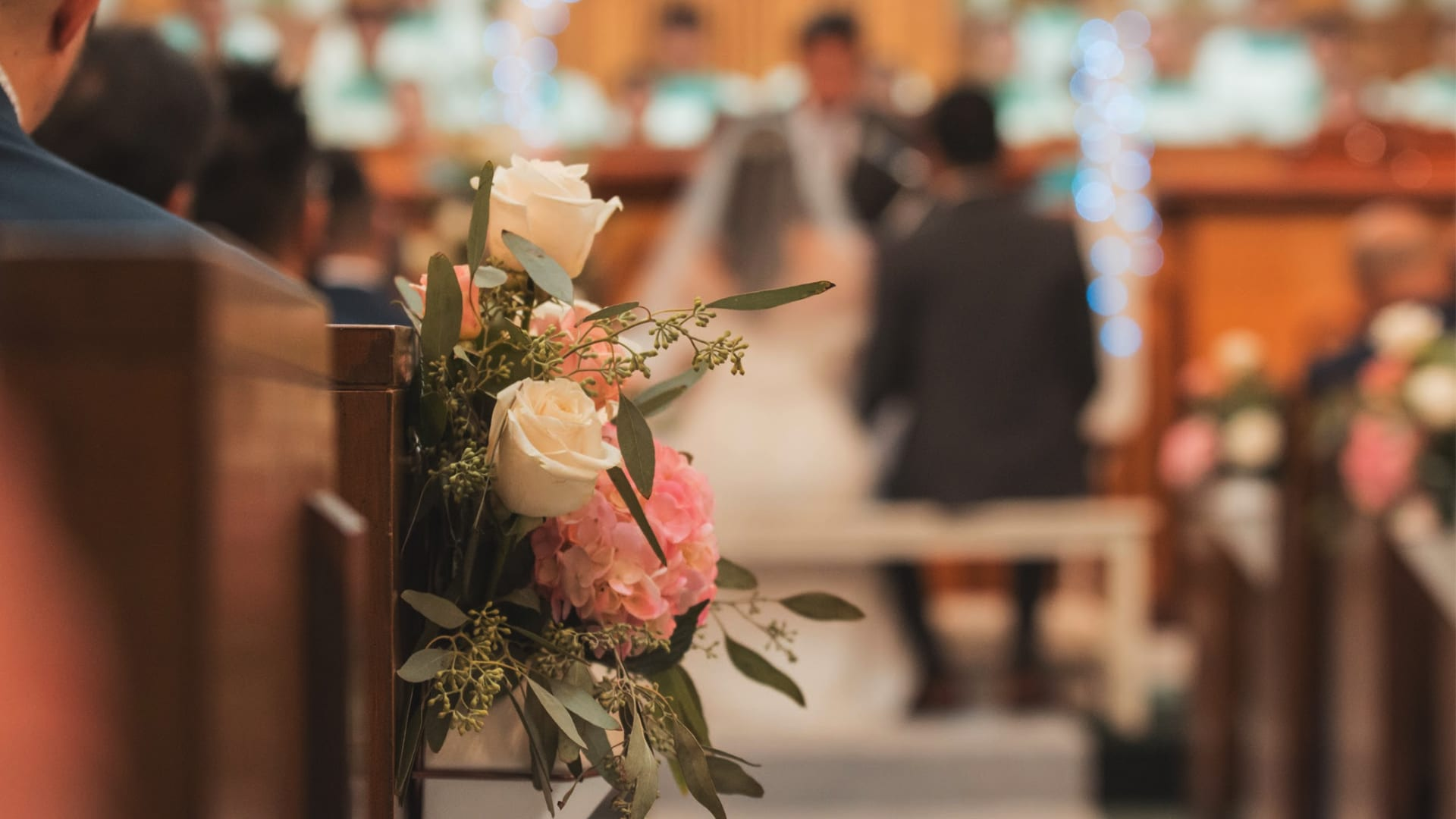 Wedding flowers and church pews