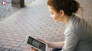 Girl looking at a screen reading a blog