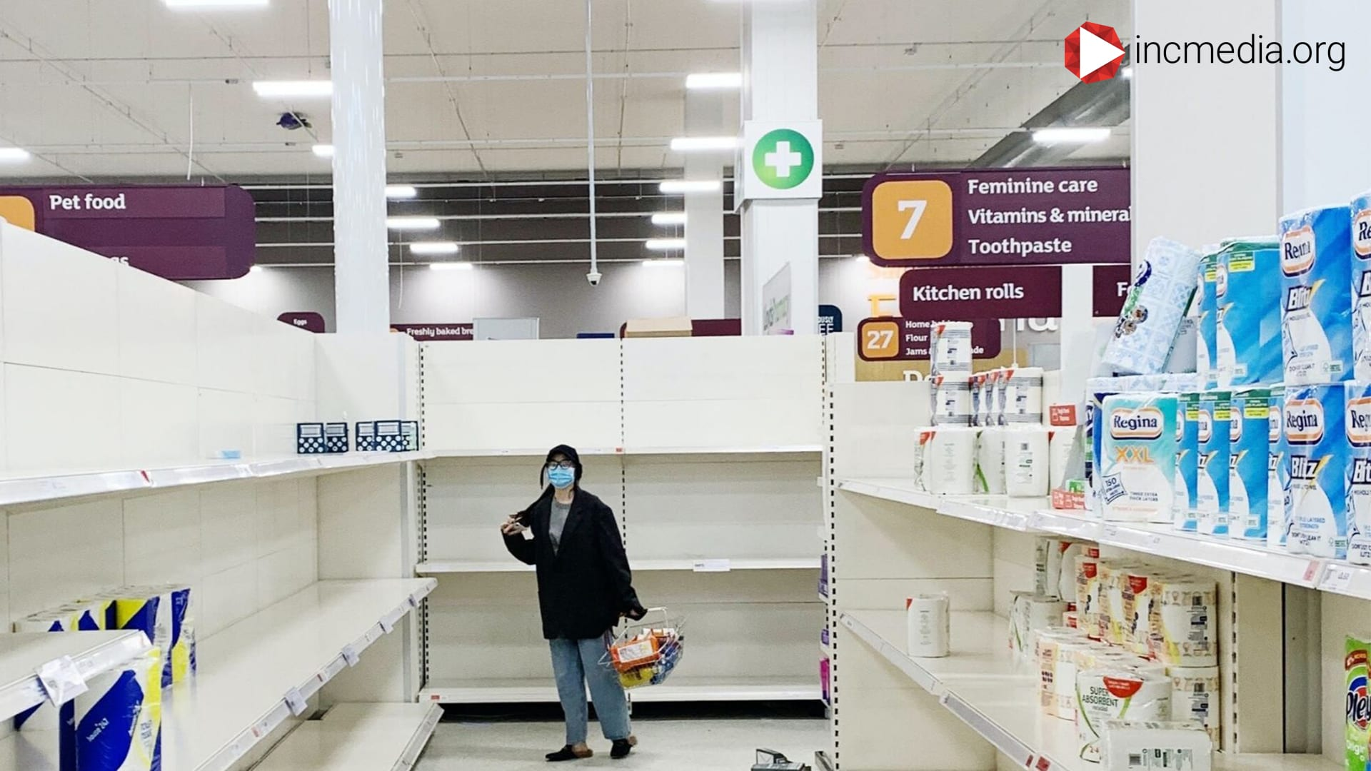 Lady in empty store aisle during cover.