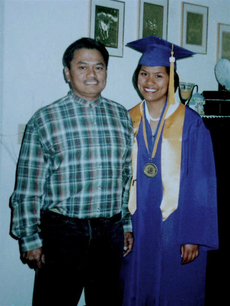 Renezen as a high school graduate with dad.