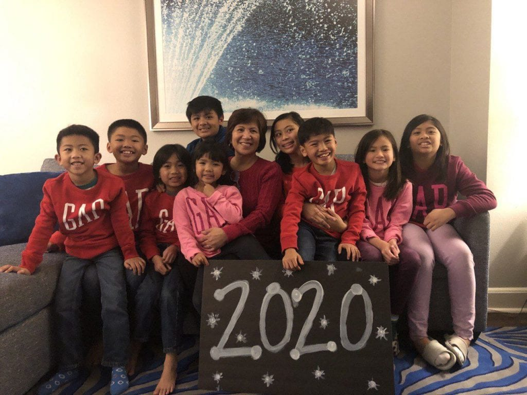 Grandkids with grandma and a 2020 sign.