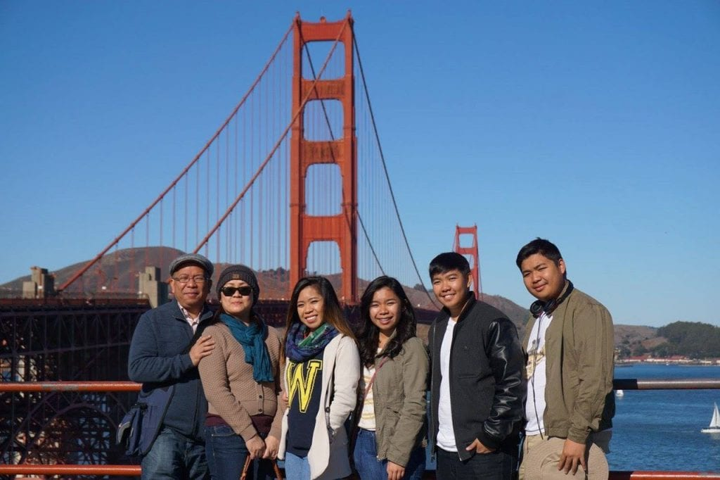Krista with family in front of Golden Gate Bridge