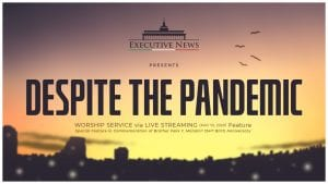 despite the pandemic text over silhouette of modern city
