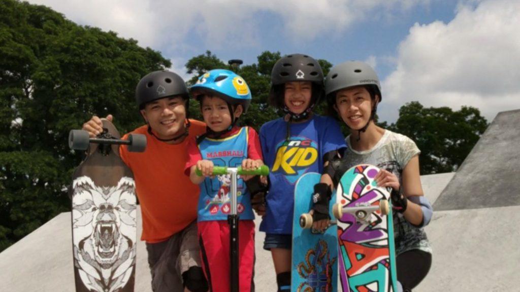 Family of four on skateboards.
