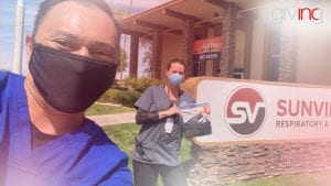Man and woman wearing medical face mask in front of clinic sign