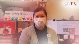 Woman at work desk with medical mask.