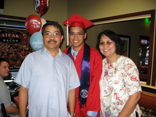 Paolo with parents at graduation party