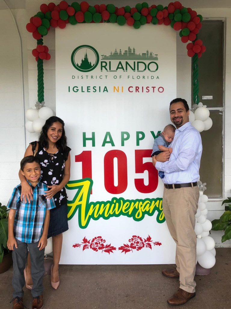 Family of four with a 105th sign.