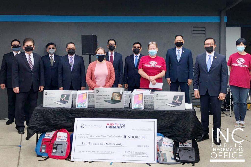Representatives from the City of Pacifica, Boys & Girls Club and the Church Of Christ pose around a table with the donated chrome books and tablets.