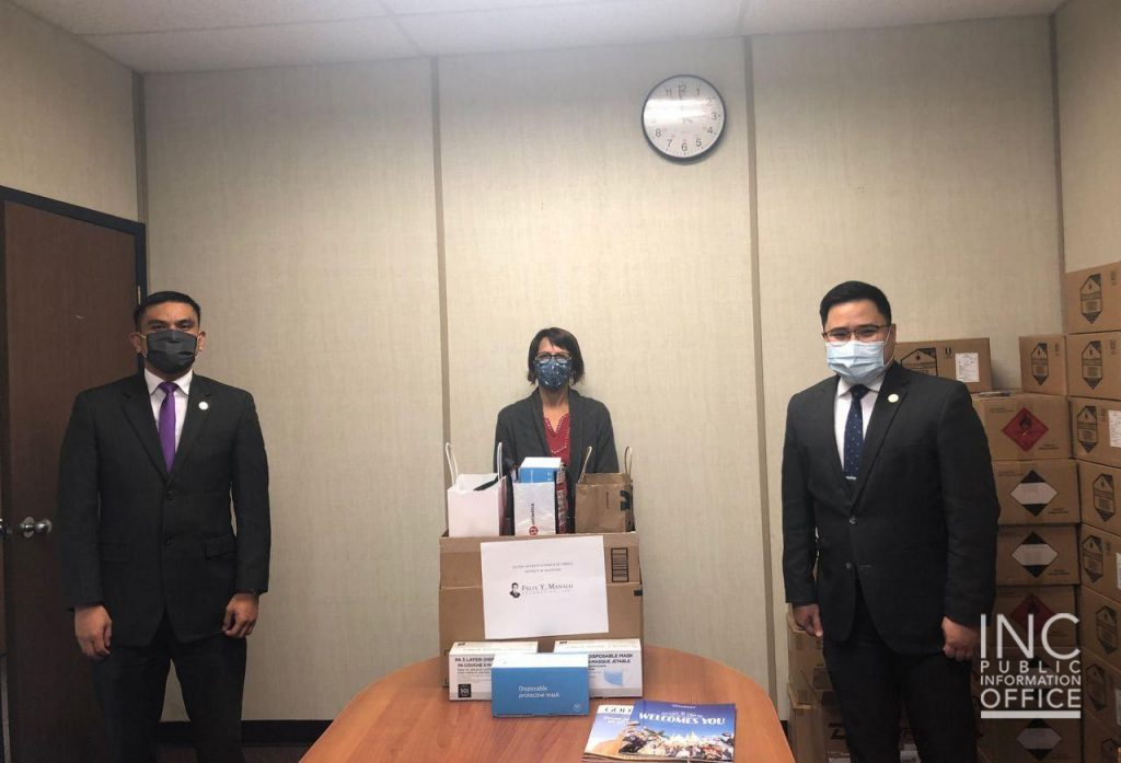 Beautiful Plains School Division Student Services Coordinator Rhonda Dickinson (center) from the Neepawa School District receives more than 1000 disposable face masks from the Church Of Christ (Iglesia Ni Cristo) through an Aid To Humanity Project.
