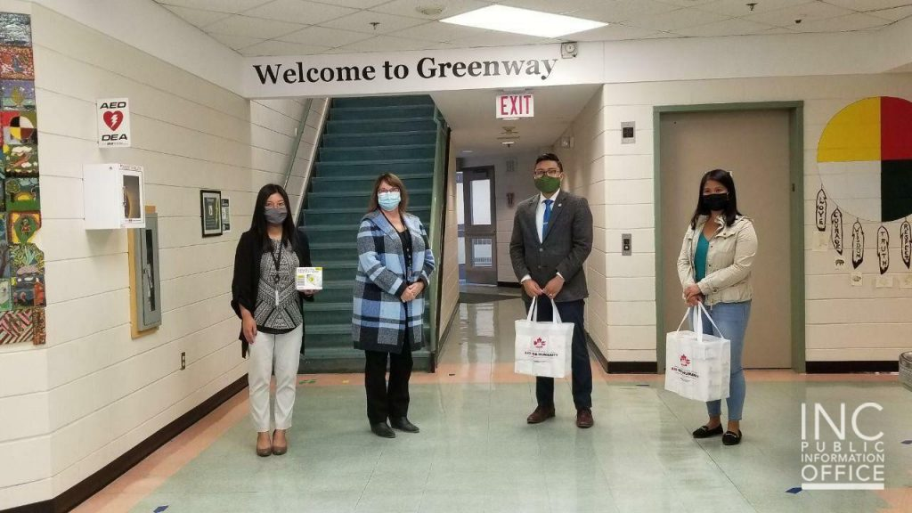Principal Stormie Duchnycz (second from left) with Vice Principal Maria Manzano (far left) gladly accepts donations from the Iglesia Ni Cristo (Church Of Christ) and the Felix Y. Manalo Foundation for students and faculty at Greenway Community School in Manitoba.