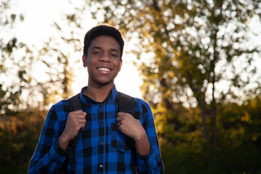 Smiling Young Man Backpack Outdoors
