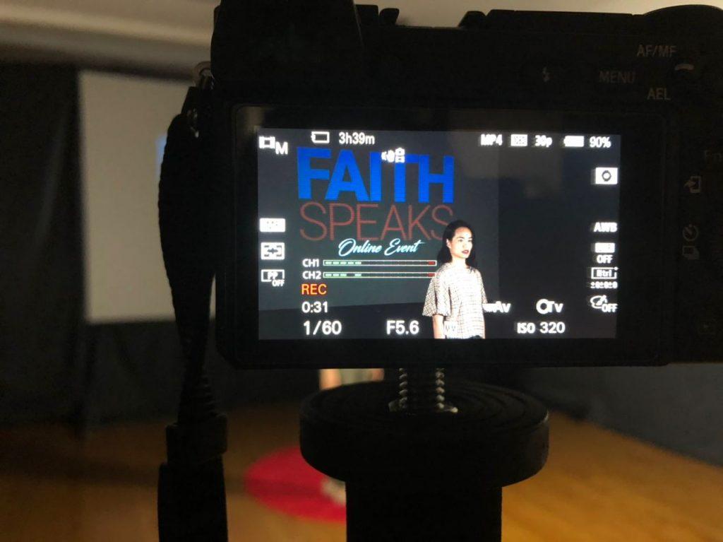 WOMAN-FRAMED-IN-CAMERA-FAITH-SPEAKS