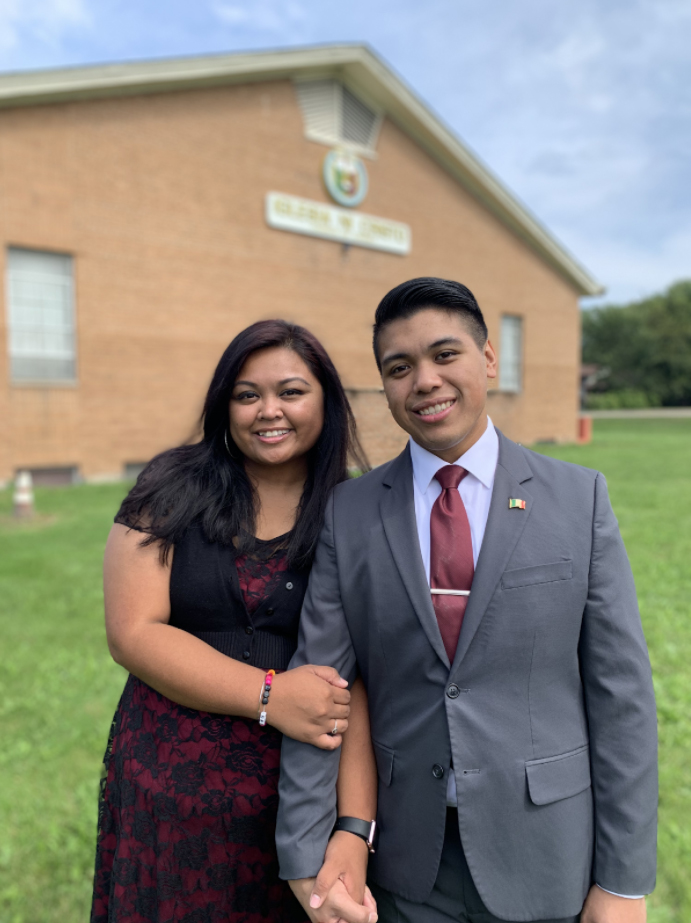 Couple standing in front of chapel
