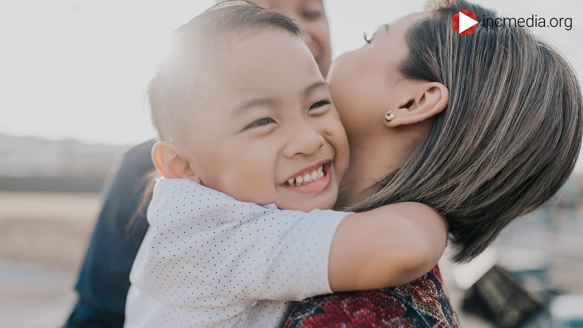 Young boy hugging mom