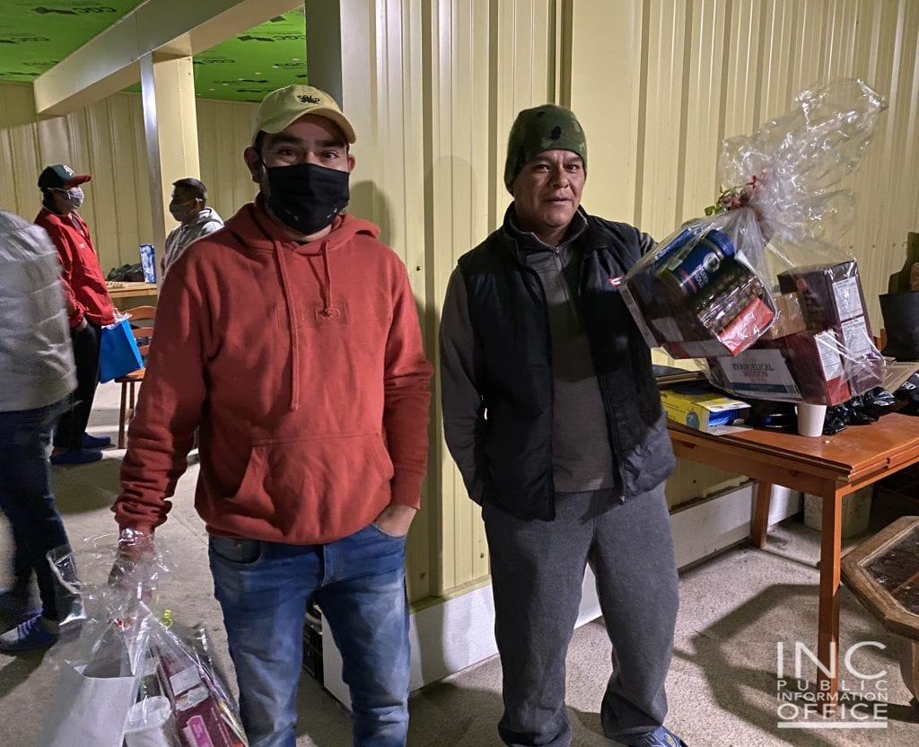 Immigrant workers in a tulip farm in Abbotsford, British Columbia smile as they received 70 care packages of clothes and from the Iglesia Ni Cristo (Church Of Christ.