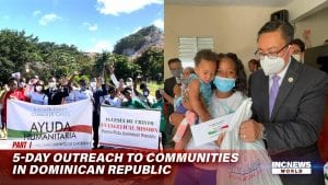 On the left, a group of people hold up two banners; on the right, a man in a suit hands a woman with a child a bag of relief goods