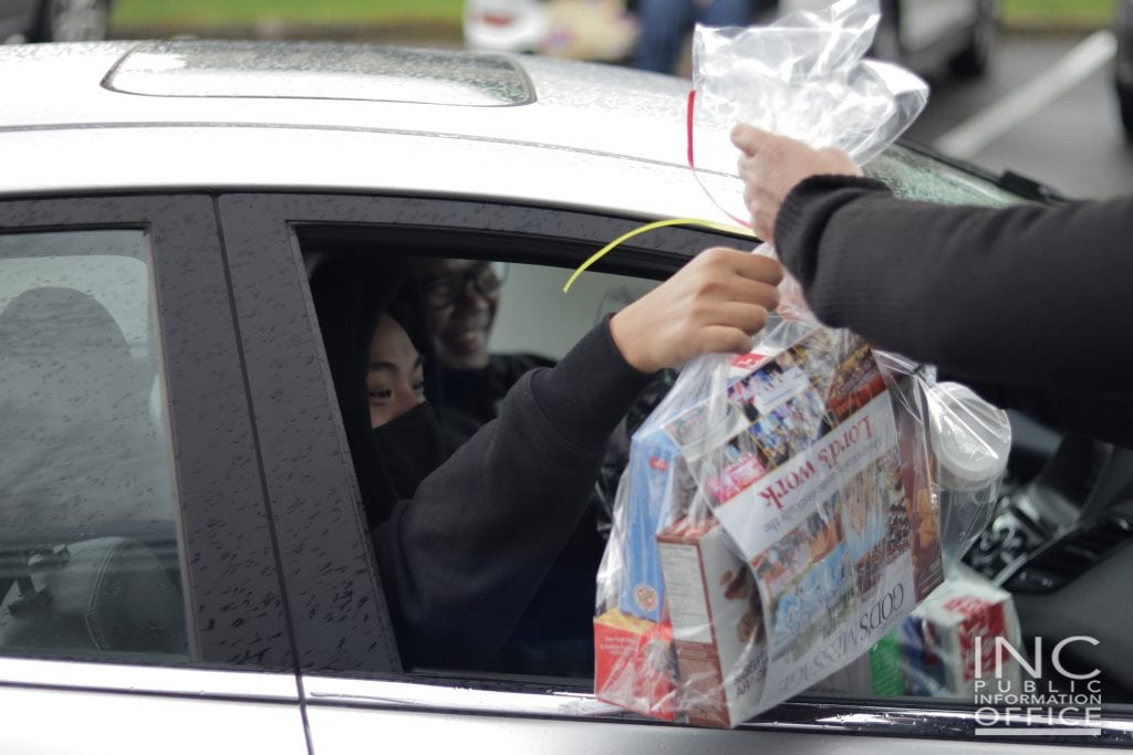 Frontliners in their vehicle were given their share of the 480 care packages available via a drive-thru Aid To Humanity initiative launched by the Iglesia Ni Cristo (Church Of Christ) in British Columbia.