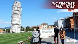 group of people posing in front of the learning tower of pisa