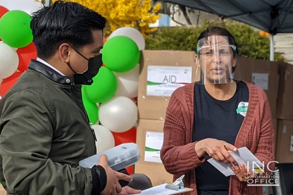 """Outside INC's Greater Toronto District Office, Seema David, wearing a face shield, expresses in an interview her appreciation for Brother Eduardo V. Manalo's """"very kind directive in providing support to 5n2 Kitchen"""" after she had reached out to him for assistance."""