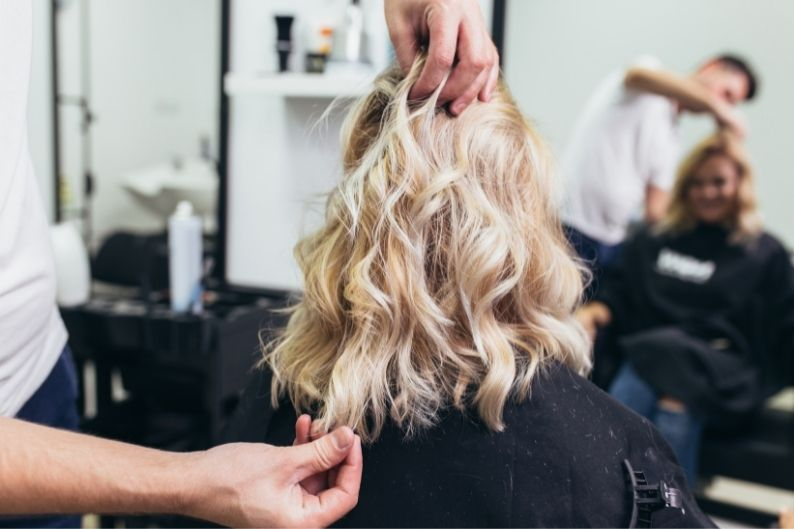 A female client comes in for her regular cut and style appointment.