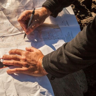 A hiker consults a topo map.