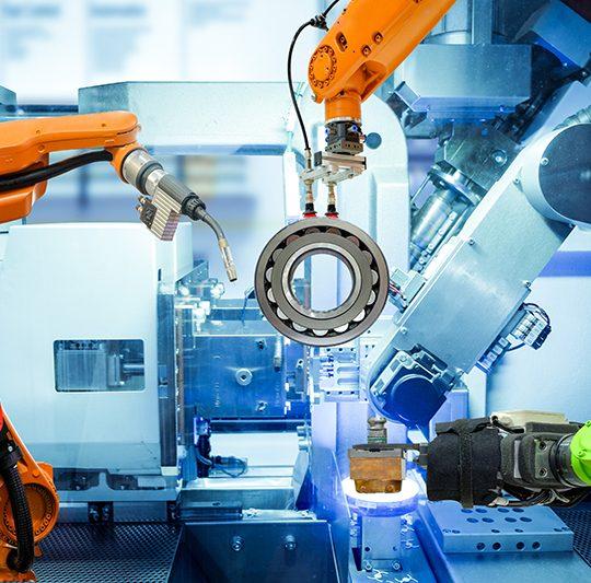 Industriell robotsvetsning och robotgrepp.