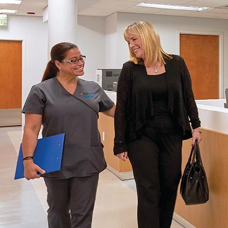 Patient with nurse at UHealth Jackson Urgent Care