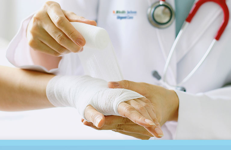 Doctor treating a minor injury at a UHealth Jackson Urgent Care center