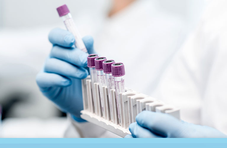 A professional running a lab and diagnostic test