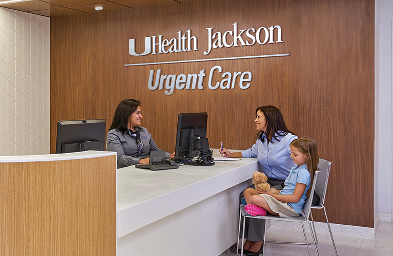 Mom and daughter being attended to by UHealth Jackson Urgent Care staff